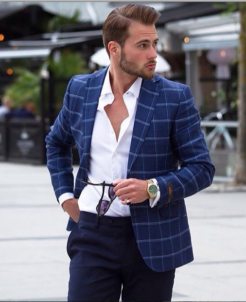 A classic appealing look for men. Blazer and a Navy pant, the white unbuttoned shirt makes the look more casual. Finished with a pair of sunglasses and this is a perfect mens summer fashion look.